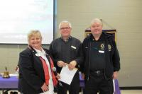 Club members Lion Larry & Barry receiving pins from DG Lion Joanne Klonikowski